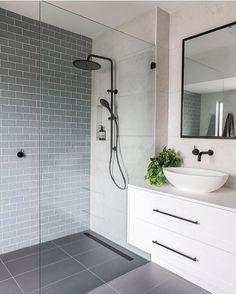 simple modern bathroom with white floating vanity, blue-gray subway tile, and la. - simple modern bathroom with white floating vanity, blue-gray subway tile, and large-format gray flo - Grey Bathrooms, White Bathroom, Bathroom Interior, Bathroom Modern, Bathroom Ideas, Bathroom Organization, Master Bathrooms, Simple Bathroom, White Shower