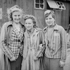 Three Russian girls still wearing their slave labour uniforms photographed soon after their arrival at No.17 Displaced Persons Assembly Centre, Hamburg Zoological Gardens.