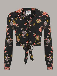 This fab blouse has a very flattering shape with a classic 40′s collar and front…