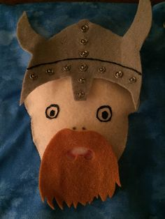 My Quiet Book - Boy, page Viking.  I used snaps to decorate the helmet.