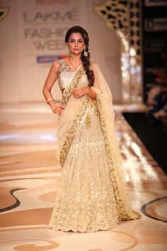 Gorgeous gold bridal lehnga designed by Vikram Phadnis for Lakme Fashion Week Summer Resort 2012.