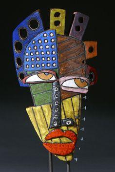 Kimmy Cantrell use cardboard to construct a face - colour op art as an idea