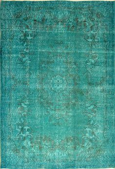 This distressed Over-Dyed rug is made from recycled vintage hand knotted Turkish rugs constructed from natural wool/cotton blend that have been shaved, bleached and then over-dyed with Rich Turquoise vegetable dyes.