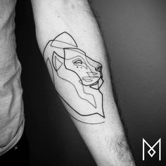 Continuous lion tattoo on the left inner forearm.