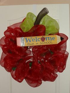 deco mesh apple wreath. obsessed it not even close to how i feel about this!