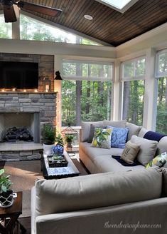 A furnished version of the fireplace back porch. I have to say it looks very nice! I The fan, the windows, the fireplace, the furnishing, the colors … - Pin Decor Four Seasons Room, Summer Porch, Room Additions, Great Rooms, My Dream Home, Home And Living, Small Living, Living Spaces, House Plans