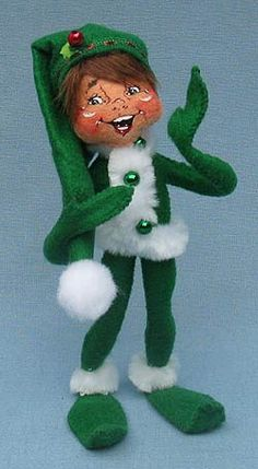 """Annalee 9"""" Green Ribbon Elf  Annalee Doll Description: Open eyes, mouth expression may vary, green body with white fur trim, hat accented with green ribbon band. Companions are 500410, 500510, 500210 and 502010."""