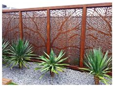 Laser cut metal patterned screens add interest and privacy.