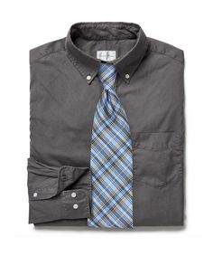 Bright plaid tie paired with a gray button down shirt.