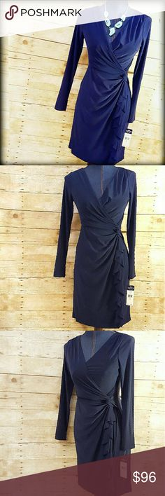 """NWT Ralph Lauren Chaps Wrap Work Dress Navy Oh-so-flattering Chaps (by Ralph Lauren) Long Sleeve dress. New with tags.Featuring a front faux-wrap and cascading ruffle that slims in all the right places! V-neck. 3/4 sleeves. Pullover style. Polyester/5% elastane. Lined bodice (poly). Machine Wash. Approx. flat measurements bust 17"""" length 35"""". Petite Small. Navy-1st pic w/ flash.  A flattering, faux-wrap classic silhouette thats perfect to go from work to an evening out for cocktails! Chaps…"""