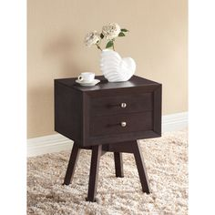 @Overstock.com - Warwick Brown Modern Nightstand - This brown wooden nightstand is equally beautiful and practical. The four legs are sturdy and won't mark your floor, and the two drawers are fitted with handy silvertone knobs. This contemporary piece will quickly improve your bedroom.  http://www.overstock.com/Home-Garden/Warwick-Brown-Modern-Nightstand/7626759/product.html?CID=214117 $87.71