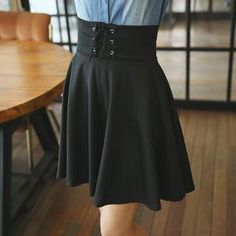Go for retro glamor in this A-line skirt. The lace up front and wider waistband create a high-waisted flattering look along with the classic A-line silhouette. The slightly thick fabric lets you wear this piece season to season. Layer tights or leggings underneath for fall and winter and finish with boots.