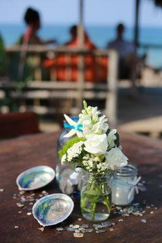 Seashells and starfish for the perfect beach reception centerpieces.