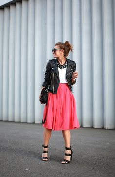 A super feminine coral skirt and a perfecto jacket, finishing off the look with a t-shirt with a pair of Steve Madden Sandals.
