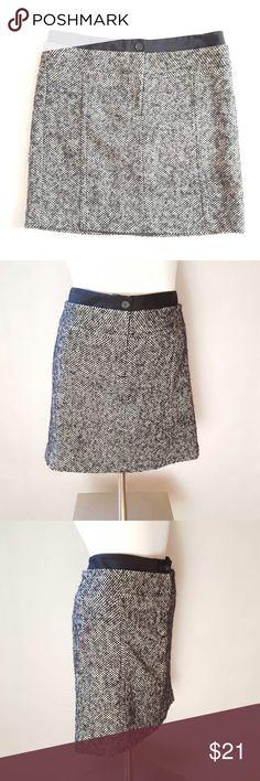 "Ann Taylor Loft Tweed Skirt Ann Taylor Loft Tweed Skirt. Stylish black band at waist. Size 6. Colors: black and white. 71% wool, 25% nylon, etc. Measurements: 33"" waist,  38"" hips, 17"" length. Ann Taylor Skirts"