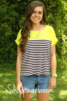 We are loving this beautiful bold yellow loose-fit top featuring Black and White stripes. Round neckline, Short sleeves, Yellow sheer feel. Wear your favorite Page 6 denim with this top for a flawless Summer look.      95% Polyester  5% Spandex  Imported  Hand Wash Cold