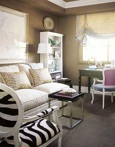 living rooms - Benjamin Moore - Shenandoah Taupe - black white zebra Louis French chair West Elm espresso wood tray top table chrome base brown gold leopard print pillows beige sand settee sofa floor lamp white bookcase desl purple blue French chair black Asian garden stool silk valance white crown molding living room