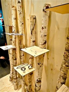 Birch branches with slots carved out to add shelves for shopping. Would work in a craft fair booth