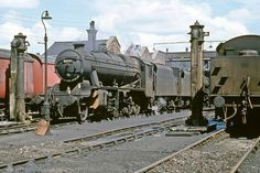 Lostock Hall Shed (10D) featuring LMS Stanier 8F 2-8-0 no. 48723 with classmate no. 48765 behind, and LMS Stanier Class 5 4-6-0 no. 45212 on the right.  24th June 1968 (Bill Wright)