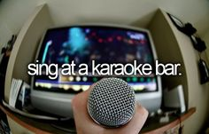 sing at a karaoke bar. [x]