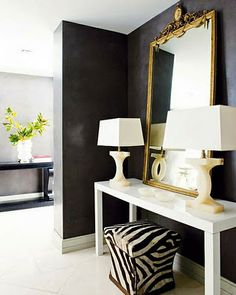 the zebra stool and the shape of the lamps brake the space from being too sober. #black-and-white
