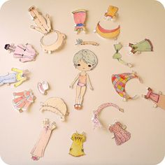 This dear little book contains an adorable paper doll with eleven colourful outfits to cut out and play with. The booklets cover is made from card