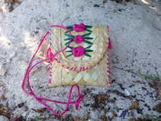 Love Ms. Paulette's #straw #coin #purse! Get yours today at www.fromaroundtheglobe.com/products