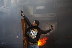 A Palestinian protester uses a slingshot to throw a stone during clashes with Israeli soldiers in the West Bank city of Hebron. The area has seen an upsurge of unrest after the death of Maysara Abu H.