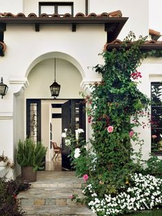 Bougainvillea climbs the exterior of this Spanish Revival bungalow,