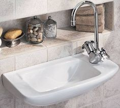 I like the recessed shelf behind tiny sink!! Perfect since there's no counter space! ;)