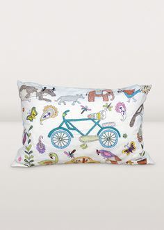 "Give your home décor a kick with this whimsical bike and animal cushion cover hand-embroidered with traditional nakshi kantha embroidery. Nakshi kantha is described as ""a woman's canvas or diary, created to tell her own story and the story of her family through thread."""