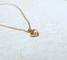 Gold chain necklace+ gold heart charm. Tiny gold necklace. Delicate gold necklace. heart necklace. Dainty gold necklace. Charm necklace.