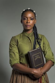 """Actress Aunjanue Ellis in """"The Book of Negroes,"""" produced by CBC TV (Canada), airing on BET. Ellis portrays [fictional] protagonist Aminata Diallo, captured [in West Africa] in her teens and spent most of her life [enslaved, not """"slave""""] in [South Carolina - colonial, slave-holding British North America, which became the USA]. Having spent most of her life in captivity, she longs to return to her homeland of Mali[?? Film says """"Guinea""""], which becomes pivotal part of her character's story."""""""