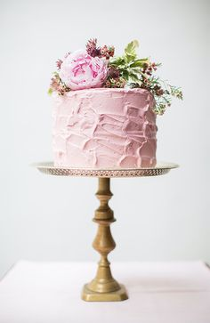 Make a statement with a delicate pink hued cake.