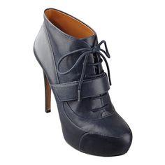 "Utilitarian inspired platform lace up oxford bootie. Leather upper. Measurements: heel 4 1/2"" and platform 1 1/4""."