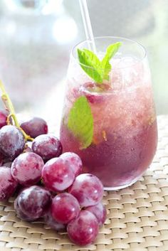 Freeze grapes and use them as ice in cocktails! It won't water them ...