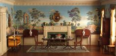 So Federal Period (1760 - 1830) with hand painted murals on walls, balanced symmetrical arrangement, ceiling dentil molding, and Thomas Sheraton inspired settee on the left. And all in 1/12th scale!