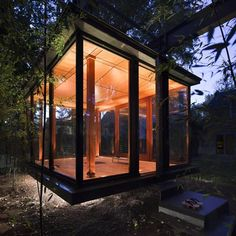 Tea House by David Jameson Architect. Glass and bronze, This musical recital room resembling a Japanese tea house hangs in the backyard of a residence northwest of Washington DC. Used for music performances, dining and contemplation. Photograph by Paul Warchol