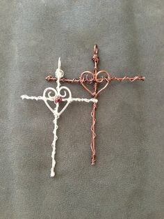 Wire Wrapped Heart/Cross pendants: one is all copper wire and the other is silver plated wire with a small garnet bead.