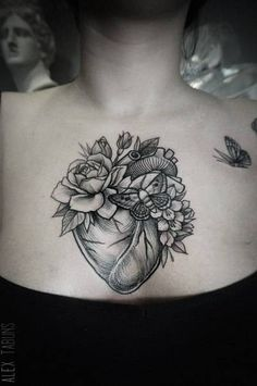 Skin Deep Tales - tattoofilter:   Floral heart on the chest. Tattoo...