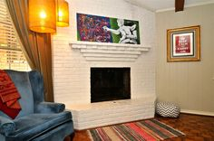 """This family's house is awesome.  And their story is better.  I love her self portrait over the fireplace, holding her child and painting.  """"A reminder to stay positive and to always keep making art."""""""
