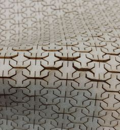 Laser cut wooden textiles design with intricate lattice pattern & flexible surface; material manipulation