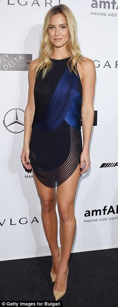 Raising the Bar! Ms. Refaeli displays her endless legs in scalloped Stella McCartney dress as she steps out of her car ahead of the amfAR Gala in Milan ~ She's hard to miss: Bar looked stunning on Saturday evening in a scalloped Stella McCartney dress with fringed overlay and nude stiletto heels