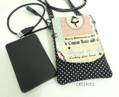 Alice in Wonderland - iPhone 6 case sleeve with detachable strap - Made to Order ₹650.00 Everyone needs that one smartphone sleeve/purse/case/cover or pouch which is soft, stylish, one of a kind, and safe for their gadgets. Made from imported Japanese cotton and linen, it's interfaced and... http://www.chezvies.ecwid.com#!/Alice-in-Wonderland-iPhone-6-case-sleeve-with-detachable-strap-Made-to-Order/p/71773551