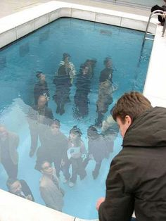 21 century museum of contemporary art Kanazawa in Japan designed by Leandro Erlich. The water is only 50cm deep and the deeper part underneath is the indoor museum.