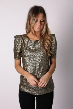 Beautiful, understated gold sequin top. Throw on a red pencil skirt and you're ready for a holiday party.