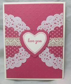 Cut a lacy doily in half to create this effect. Match or compliment your background color with circles of dotted paper covered with yet more lace, this time a band of ribbon! Top it all off with a heart-shaped sentiment.