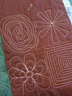 The ultimate site to learn how to do FMQ. Check out the spirals!  This idea would carry over to making pillows, simple and clean.