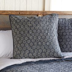 MOONFLOWER LIGHTWEIGHT SHAM--Resist-printed cotton lends depth and beauty to this bedding accented with white flowers and kantha stitching. Imported.