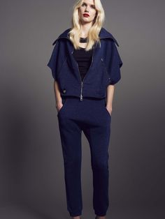 Model wears Naughty Dog cardigan and jogging trousers made in glittered fleece fabric
